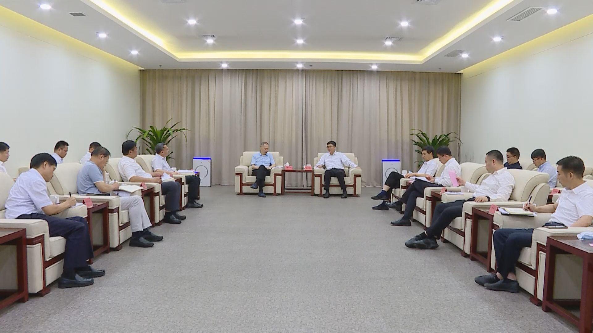 陈刚与中国铁建集团董事长陈奋健一行举行工作座谈