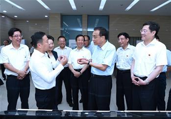 Premier Li calls for faster economic upgrade